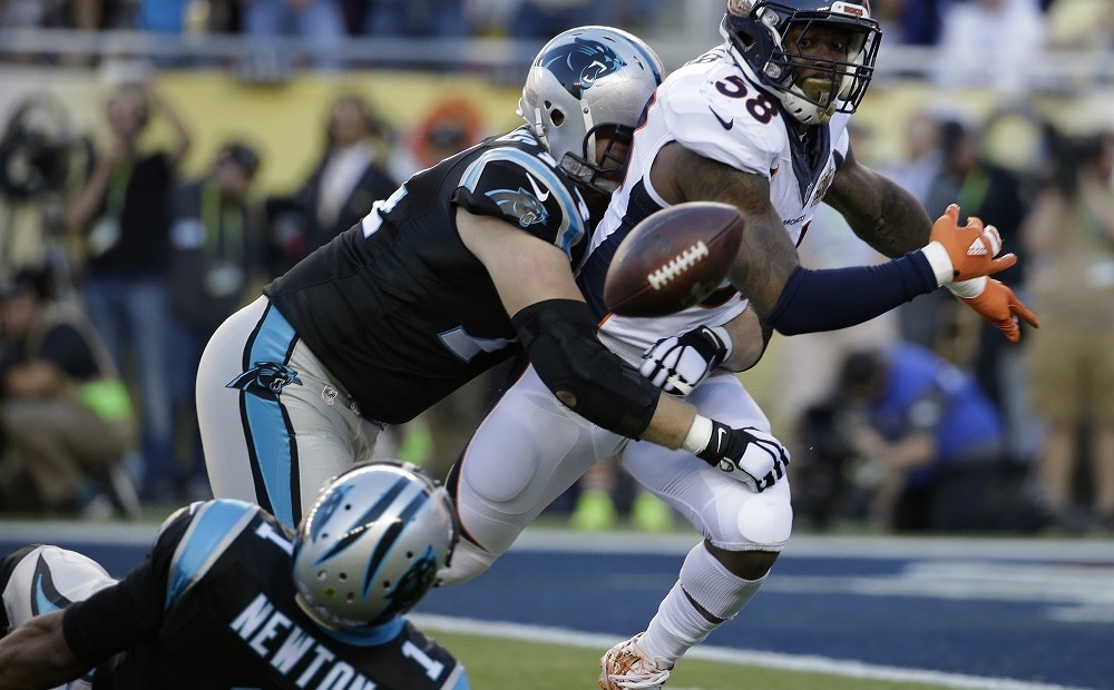 Denver Broncos' Von Miller (58) strips the ball from Carolina Panthers' Cam Newton (1) during the first half of the NFL Super Bowl 50 football game Sunday, Feb. 7, 2016, in Santa Clara, Calif. The Broncos recovered the fumble for a touchdown. (AP Photo/Marcio Jose Sanchez)