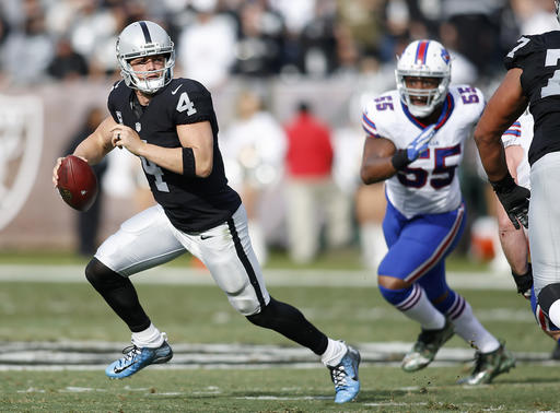 Oakland Raiders quarterback Derek Carr (4) scrambles from Buffalo Bills defensive end Jerry Hughes (55) during the first half of an NFL football game in Oakland, Calif., Sunday, Dec. 4, 2016. (AP Photo/D. Ross Cameron)