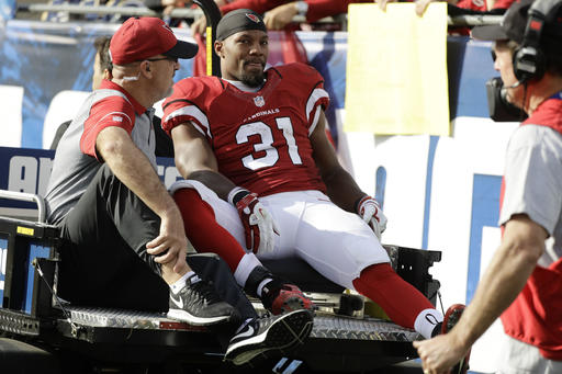 FILE - In this Jan. 1, 2017, file photo, Arizona Cardinals running back David Johnson is taken off the field after being injured during the first half of an NFL football game against the Los Angeles Rams in Los Angeles. In what coach Bruce Arians called ``great news,'' Johnson's knee injury is not serious and will not require surgery. (AP Photo/Jae C. Hong, File)